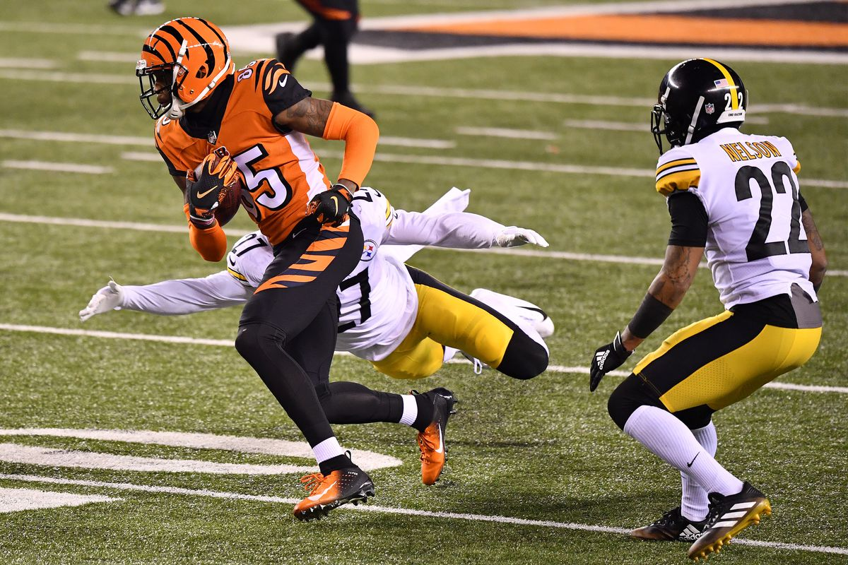 Tee Higgins #85 of the Cincinnati Bengals makes a reception past Marcus Allen #27 of the Pittsburgh Steelers during the second quarter at Paul Brown Stadium on December 21, 2020 in Cincinnati, Ohio.