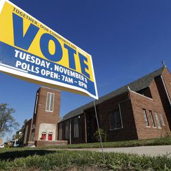A get out the vote sign is shown outside St. Matthew Missionary Baptist Church in Detroit, Mich., on Nov. 6, 2016. Macomb County, just north of Detroit, may have single-handedly swung Michigan to Trump.