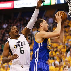 Golden State Warriors guard Klay Thompson #11 takes a shot under Utah Jazz forward Joe Johnson #6 during game four of the Western Conference Semifinal at Vivant Smart Home Arena in Salt Lake City on Monday, May 8, 2017.