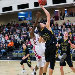 Alex Lamb (10) takes the ball to the rim over the Layton Christian defense on Friday, Dec. 8, 2017.