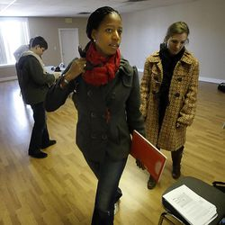 Saratoga Springs Mayor, Mia Love, left, leaves after the interview Thursday, Dec. 22, 2011 about her plans to run for Congress at what will become her campaign headquarters in South Jordan.