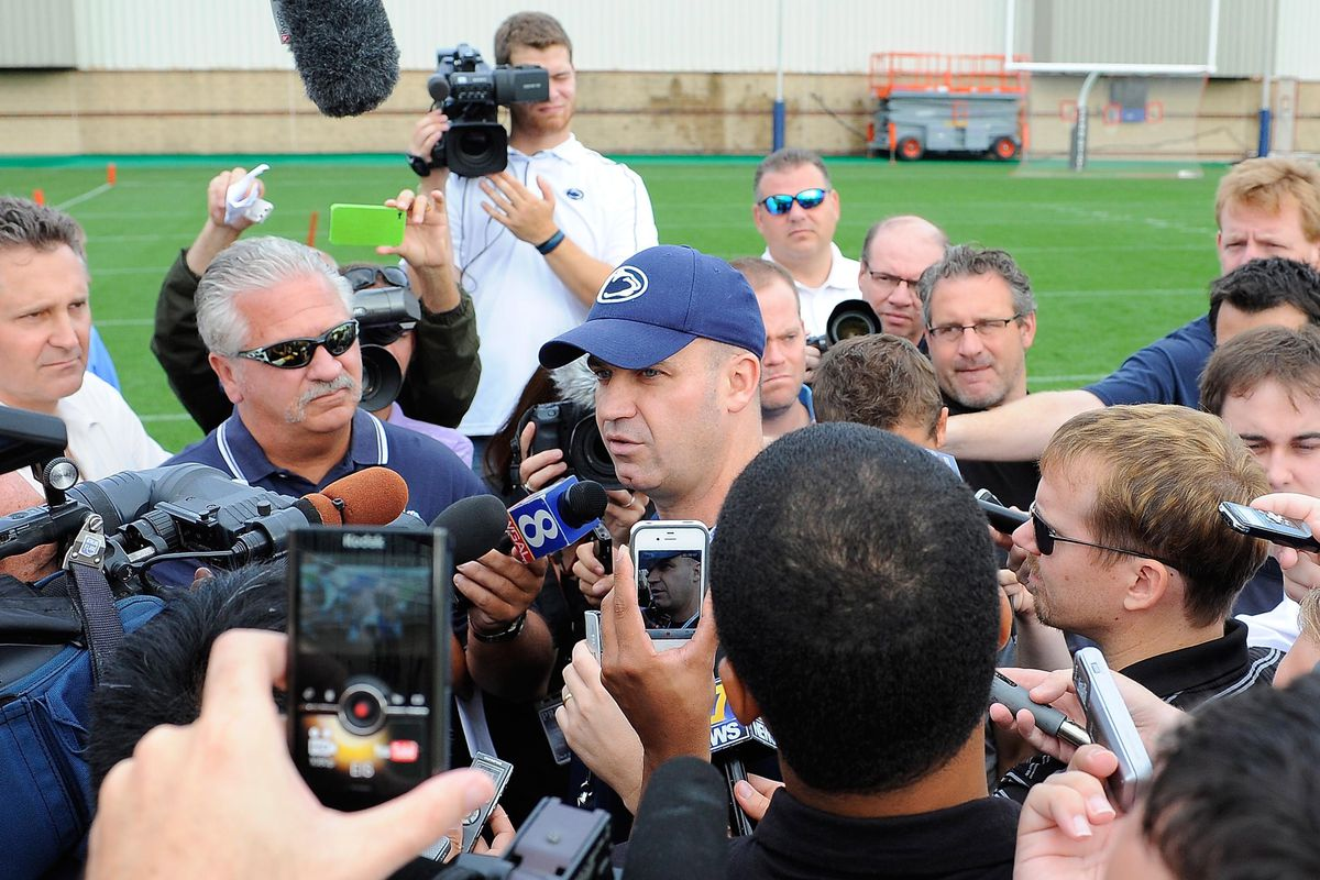 Aug 6, 2012; University Park, PA, USA; Penn State Nittany Lions head coach Bill O'Brien speaks with members of the media following the first day of practice at the Lasch Football Building practice fields. Mandatory Credit: Rich Barnes-US PRESSWIRE