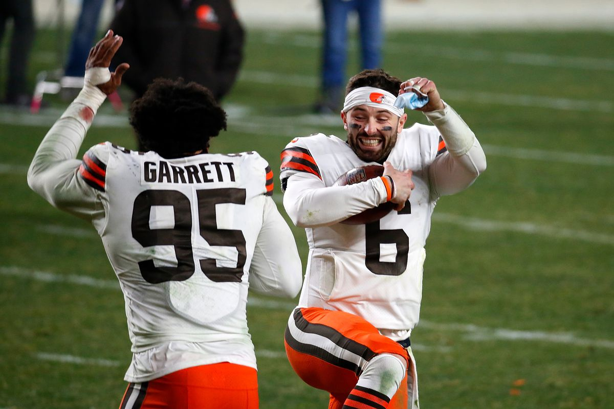 Baker Mayfield #6 and Myles Garrett #95 of the Cleveland Browns celebrate a victory over the Pittsburgh Steelers in the AFC Wild Card Playoff game at Heinz Field on January 10, 2021 in Pittsburgh, Pennsylvania.