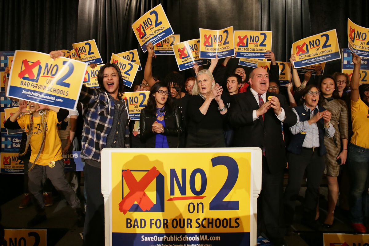 Anti-charter school activists celebrate results at an election night Massachusetts Democrats and anti-Question Two watch party at Copley Plaza Hotel in Boston on Nov. 8, 2016. (Photo by Barry Chin/The Boston Globe via Getty Images)