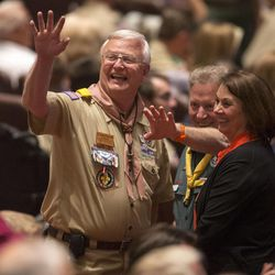 Scout leaders wave to friends as the find their seats. Thousands of scouts and their leaders assemble Tuesday, Oct. 29, 2013 in the Conference Center in Salt Lake City to celebrate a century of honor.
