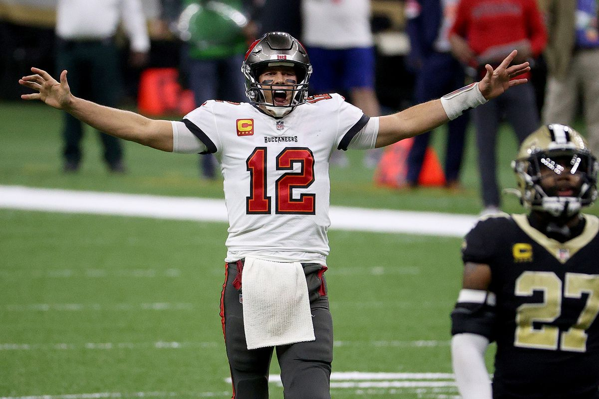 Tom Brady #12 of the Tampa Bay Buccaneers celebrates a first down against the New Orleans Saints late in the fourth quarter in the NFC Divisional Playoff game at Mercedes Benz Superdome on January 17, 2021 in New Orleans, Louisiana.