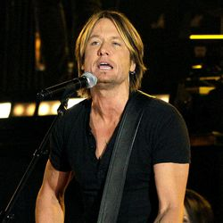 FILE - In this Nov. 9, 2011 file photo, singer Keith Urban performs during the 45th Annual CMA Awards in Nashville, Tenn.  Urban  emerged from his surgery to remove a polyp and a nodule from his vocal cords with benefits he never imagined.