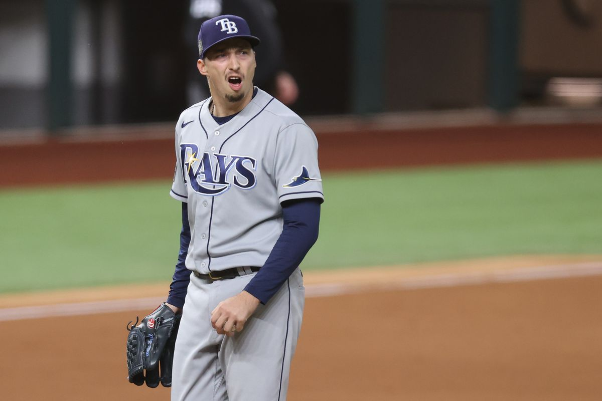 Blake Snell #4 of the Tampa Bay Rays reacts as he is being taken out of the game against the Los Angeles Dodgers during the sixth inning in Game Six of the 2020 MLB World Series at Globe Life Field on October 27, 2020 in Arlington, Texas.