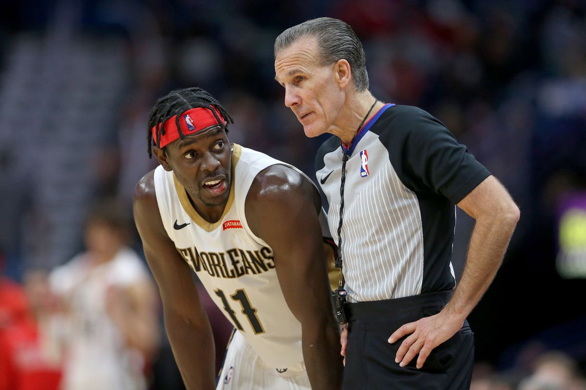 New Orleans Pelicans guard Jrue Holiday talks to referee Ken Mauer in the second half against the Golden State Warriors at Smoothie King Center.