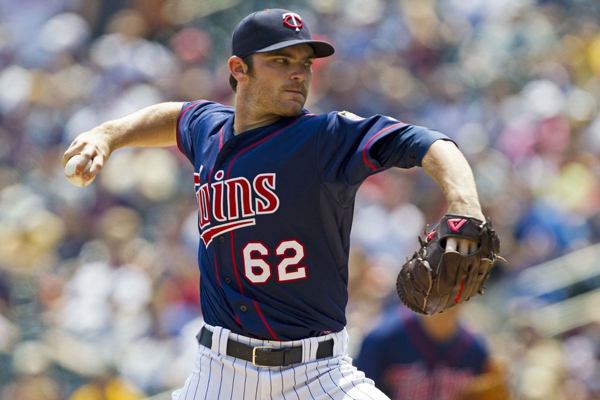 June 16, 2012; Minneapolis, MN, USA: Minnesota Twins starting pitcher Liam Hendriks (62) delivers a pitch in the first inning against the Milwaukee Brewers at Target Field. Mandatory Credit: Jesse Johnson-US PRESSWIRE