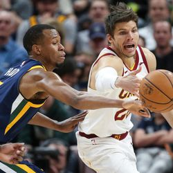 Utah Jazz guard Rodney Hood (5) and Cleveland Cavaliers guard Kyle Korver (26) compete for a loose ball during the game at Vivint Arena in Salt Lake City on Saturday, Dec. 30, 2017.