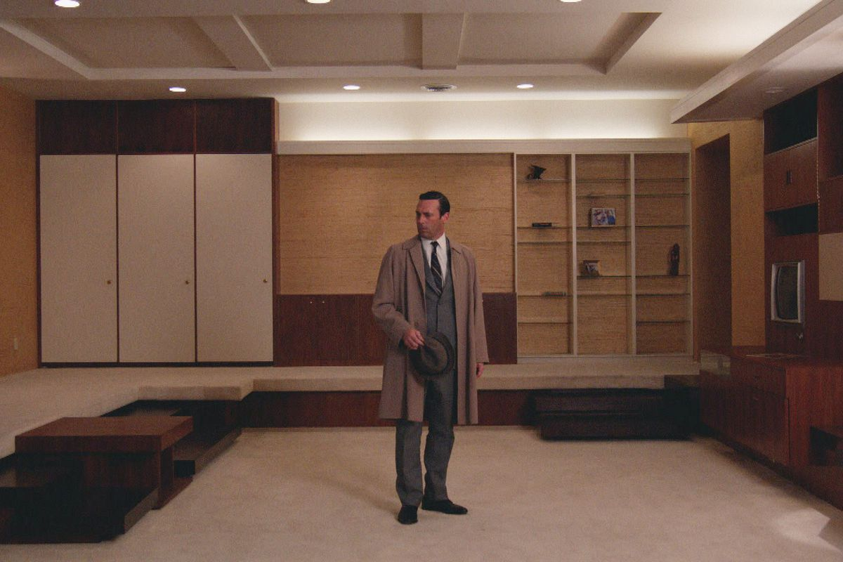 Don confronts his empty apartment, a symbol of his slowly dissolving life.
