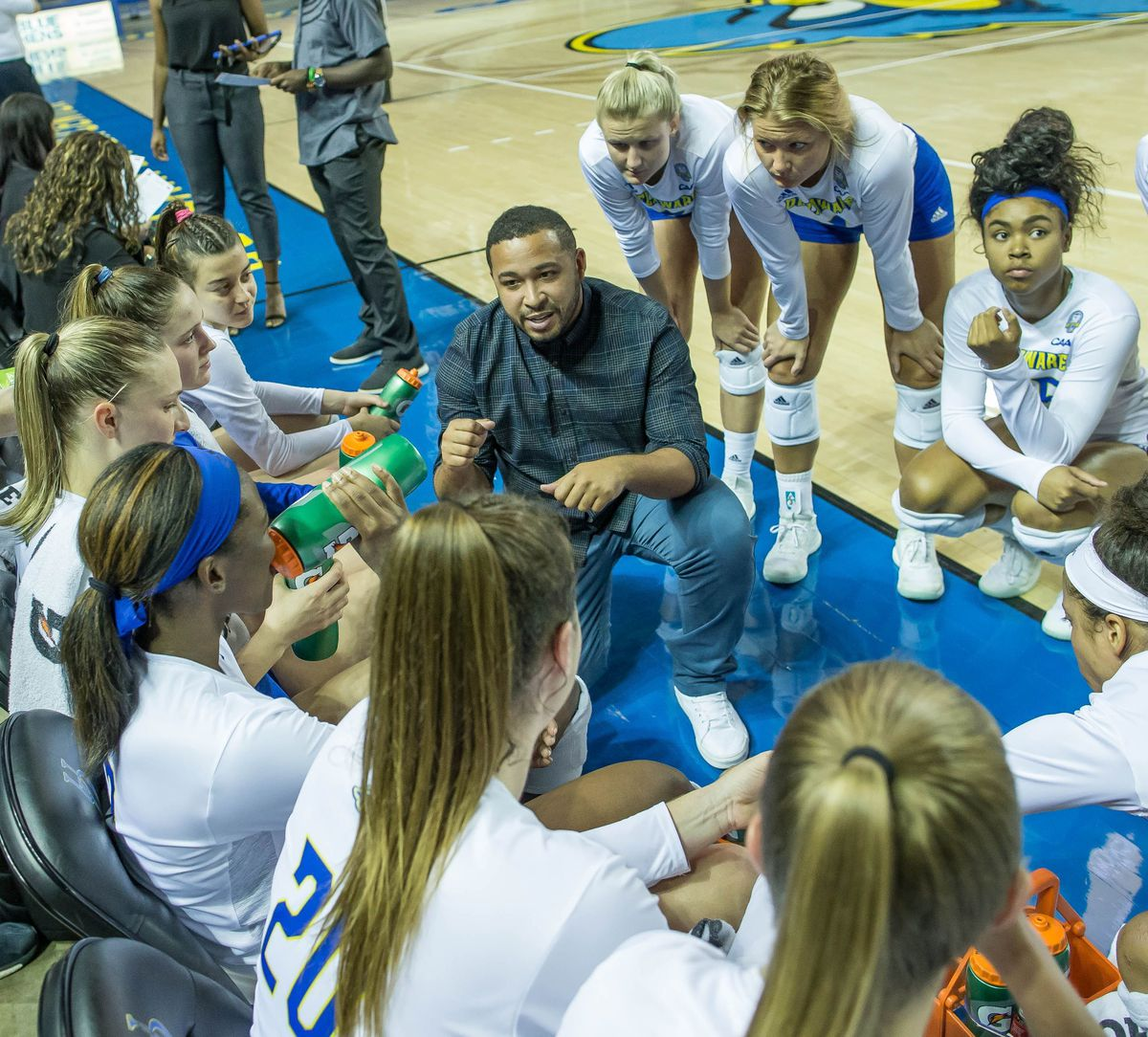 Keith Anderson in the huddle while at the University of Delaware.