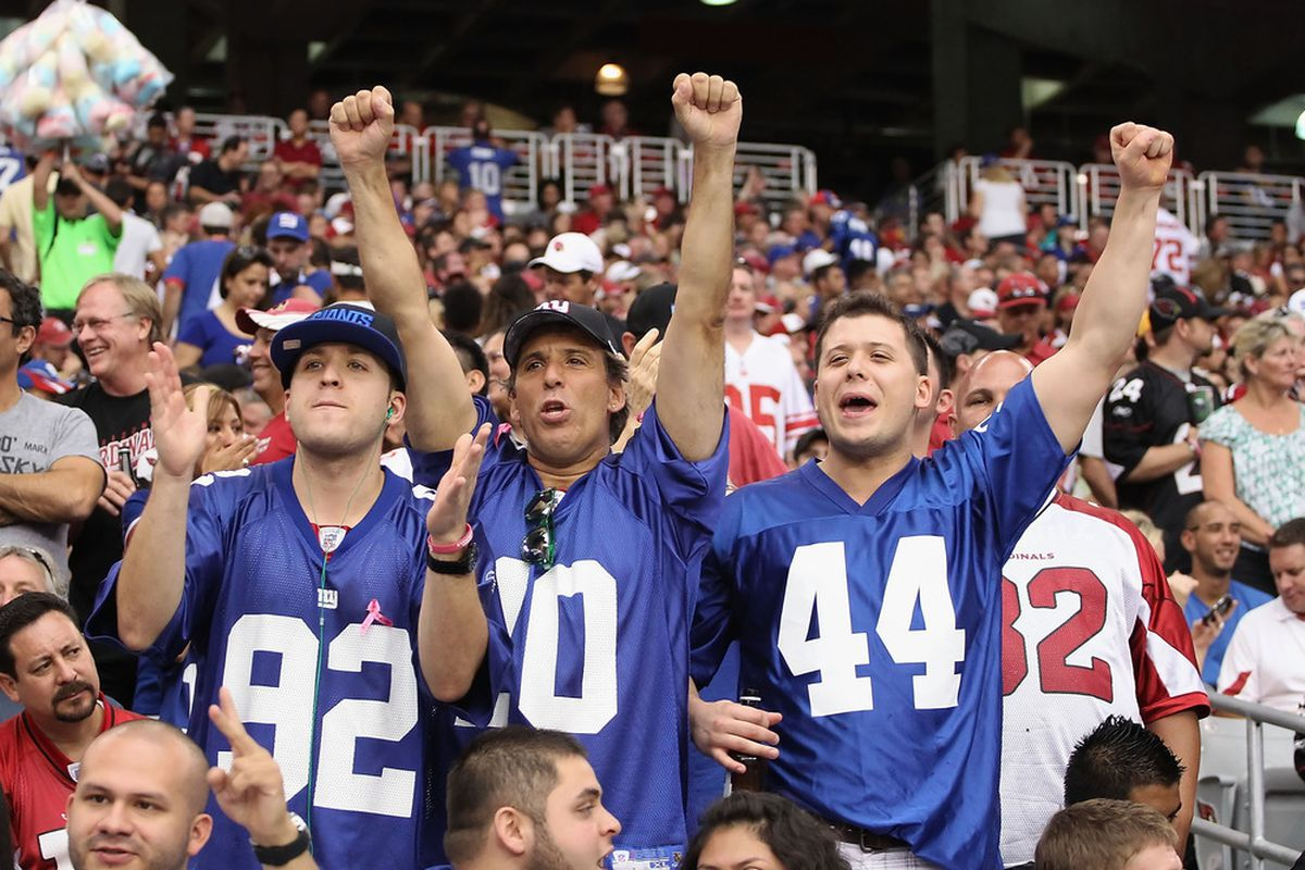 See the guy on the left in the Cardinal jersey? That look pretty much sums up how Cardinal fans feel about Giants fans.