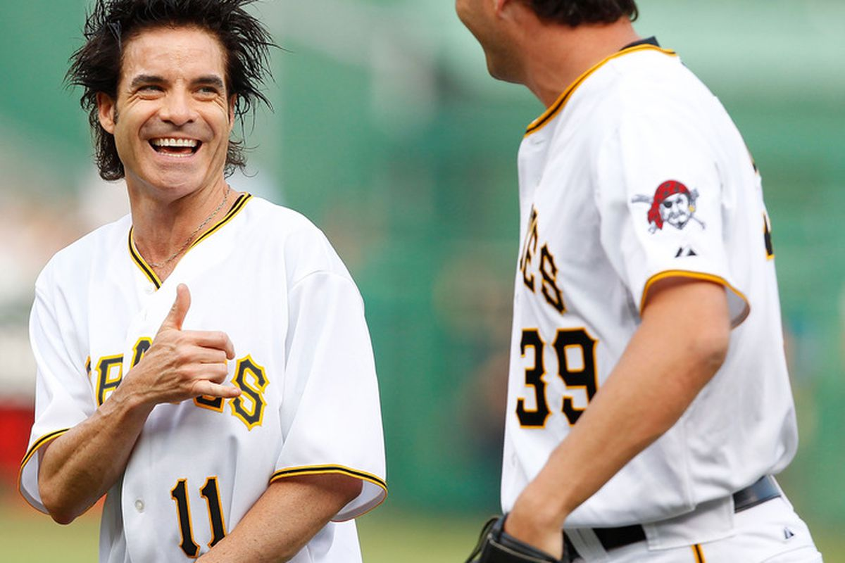 WHAT THE CRAP THAT'S THE GUY FROM TRAIN WITH JASON GRILLI, AND THEY'RE BOTH WEARING PIRATES JERSEYS THOSE TURNCOATS