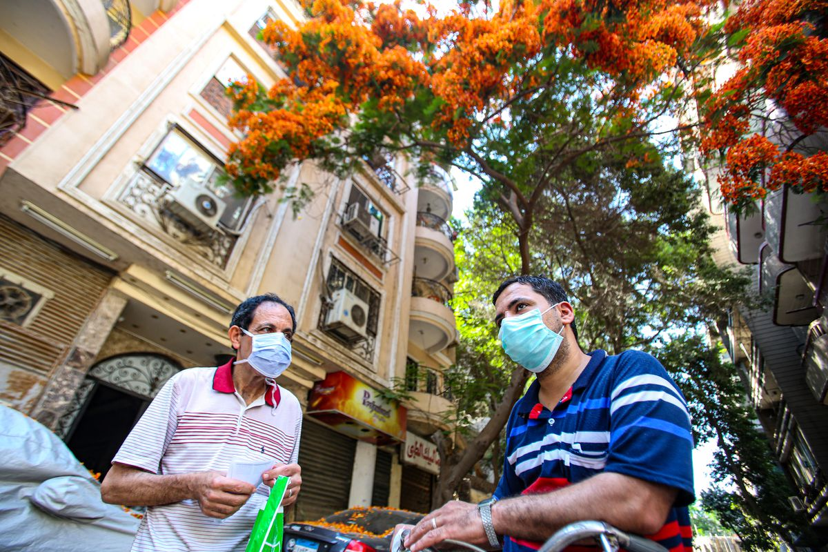 People wear face masks, amid the Coronavirus outbreak in Cairo, Egypt.