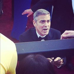 George was the only celebrity to jump the security line to greet his fans. [Photo by Natalie Alcala]