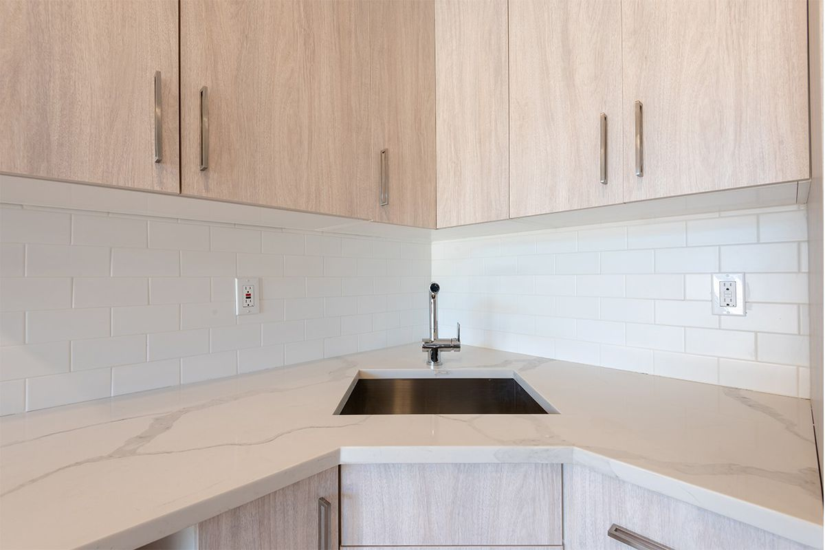 A kitchen with light brown cabinetry.