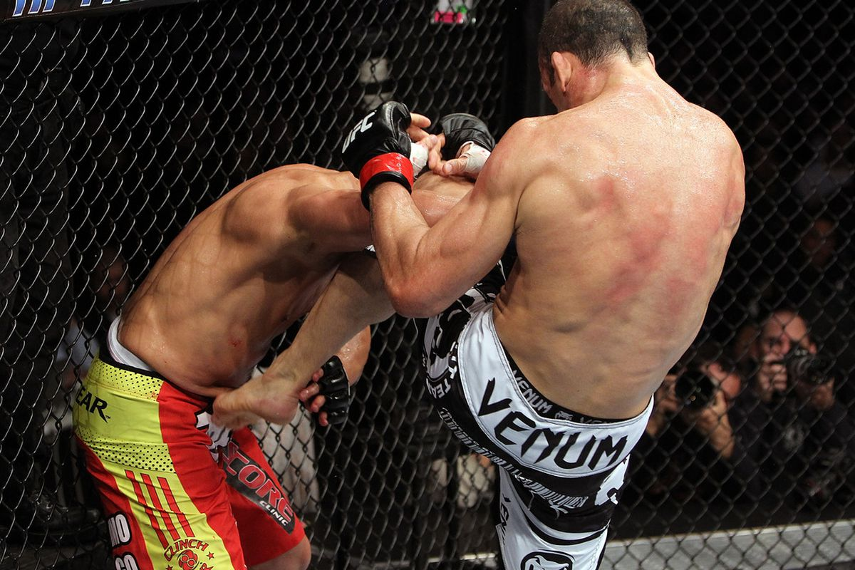 SAN JOSE, CA - NOVEMBER 19: (R-L) Wanderlei Silva knees Cung Le in the head during an UFC Middleweight bout at the HP Pavillion on November 19, 2011 in San Jose, California. (Photo by Josh Hedges/Zuffa LLC/Zuffa LLC via Getty Images)