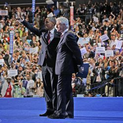 President Barack Obama joins former President Bill Clinton on stage at the Democratic National Convention, Wednesday, Sept. 5, 2012, in Charlotte, N.C.