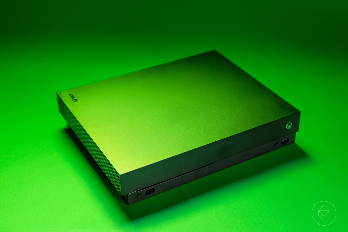photo Xbox One X left front angle from above, on green background