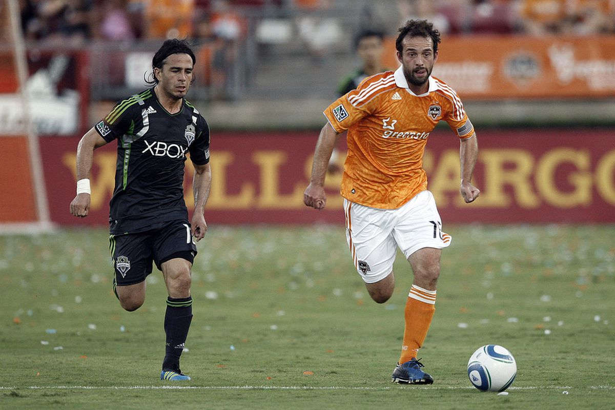HOUSTON - JULY 30:  Midfielder Adam Moffat #16 of the Houston Dynamo races down the field as Mauro Rosales #10 of the Seattle Sounders pursues at Robertson Stadium on July 30, 2011 in Houston, Texas.  (Photo by Bob Levey/Getty Images)