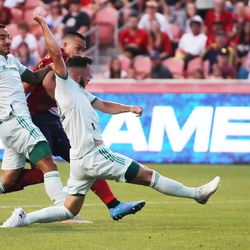 Real Salt Lake forward Bobby Wood (7) scores a goal past Colorado Rapids defender Keegan Rosenberry (2) at Rio Tinto Stadium in Sandy on Saturday, July 24, 2021. Real won 3-0.