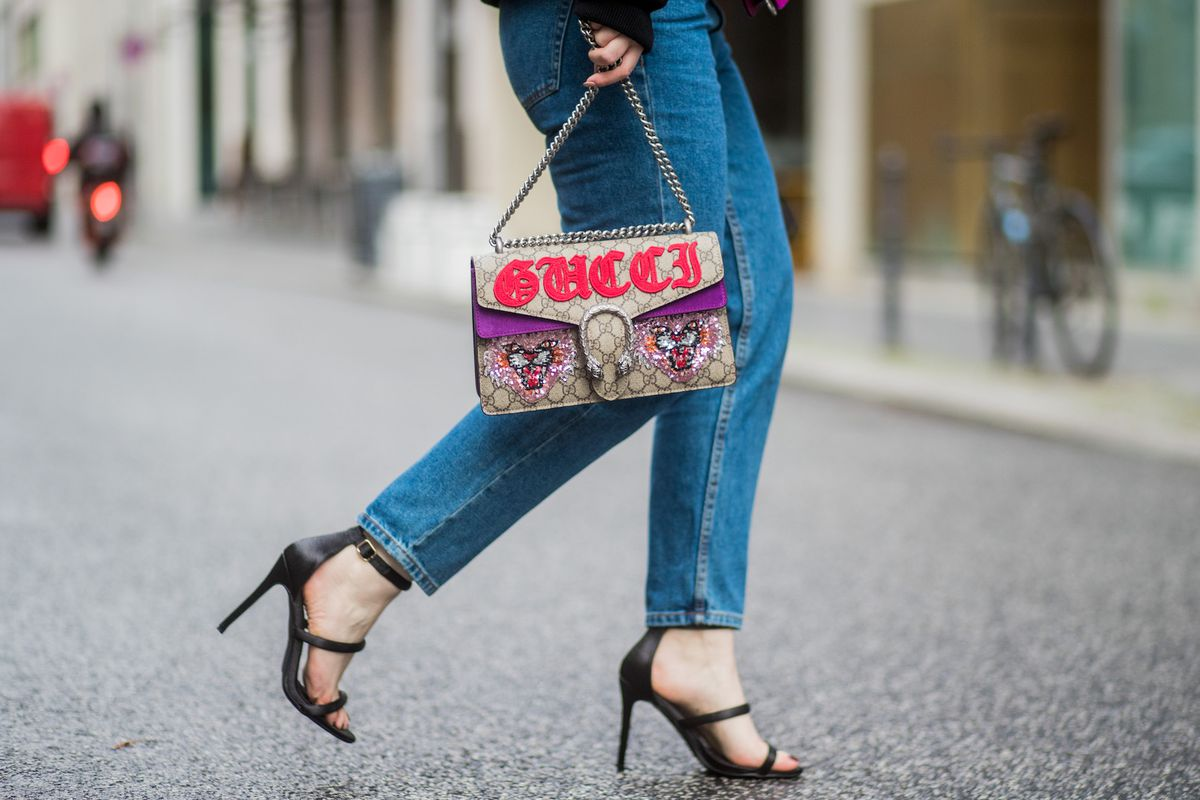 Fashion blogger Maria Barteczko carries an embroidered Dionysus bag Gucci on the streets of Berlin.
