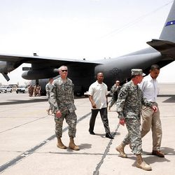 Barack Obama talks with Gen. David Petraeus, in July 2008 on a runway at Baghdad International Airport in Iraq.