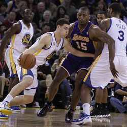 """In this photo made April 18, 2012, Golden State Warriors' Klay Thompson drives the ball against Los Angeles Lakers' Metta World Peace during the first half of an NBA basketball game in Oakland, Calif. Klay Thompson is so calm and quiet that teammates often tease him just trying to get a reaction. """"A silent assassin,"""" coach Mark Jackson calls him. A fitting nickname, too. With the Warriors missing the playoffs again, Thompson has quietly put together a season that might land the first-round pick on the NBA's All-Rookie team."""