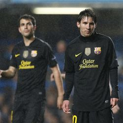 Barcelona's Lionel Messi, centre, reacts as his team plays Chelsea during their Champions League semifinal first leg soccer match at Chelsea's Stamford Bridge stadium in London,Wednesday, April 18, 2012.