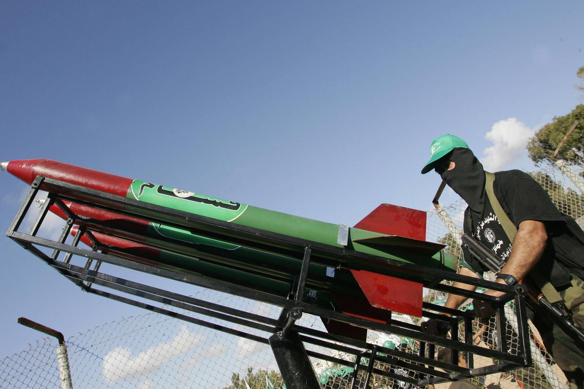 A member of Hamas displays rockets in Gaza City