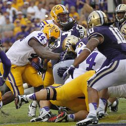LSU fullback J.C. Copeland (44) scores a touchdown during the first half of an NCAA college football game against Washington in Baton Rouge, La., Saturday, Sept. 8, 2012.