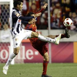 Fabian Espindola of Real Salt Lake fights for control of the ball against Hector Miguel Morales from the Rayados of Monterrey during the final game of the CONCACAF championship at Rio Tinto Stadium in Sandy Wednesday, April 27, 2011.