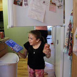 BYU student Kelsey Morasco gets some ice and a drink  in her apartment in Provo April 29, 2012.