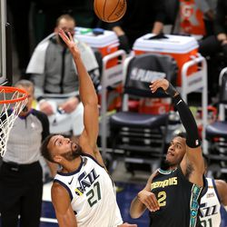 Utah Jazz center Rudy Gobert (27) tries to defend Memphis Grizzlies center Xavier Tillman (2) as the Utah Jazz and the Memphis Grizzlies play in game one of their NBA playoff series at Vivint Arena in Salt Lake City on Sunday, May 23, 2021.