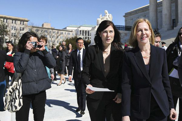 Center for Reproductive Rights senior litigation director Julie Rikelman (center) and president Nancy Northrup (right) standing outside the Supreme Court.