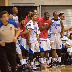 The Detroit bench celebrates
