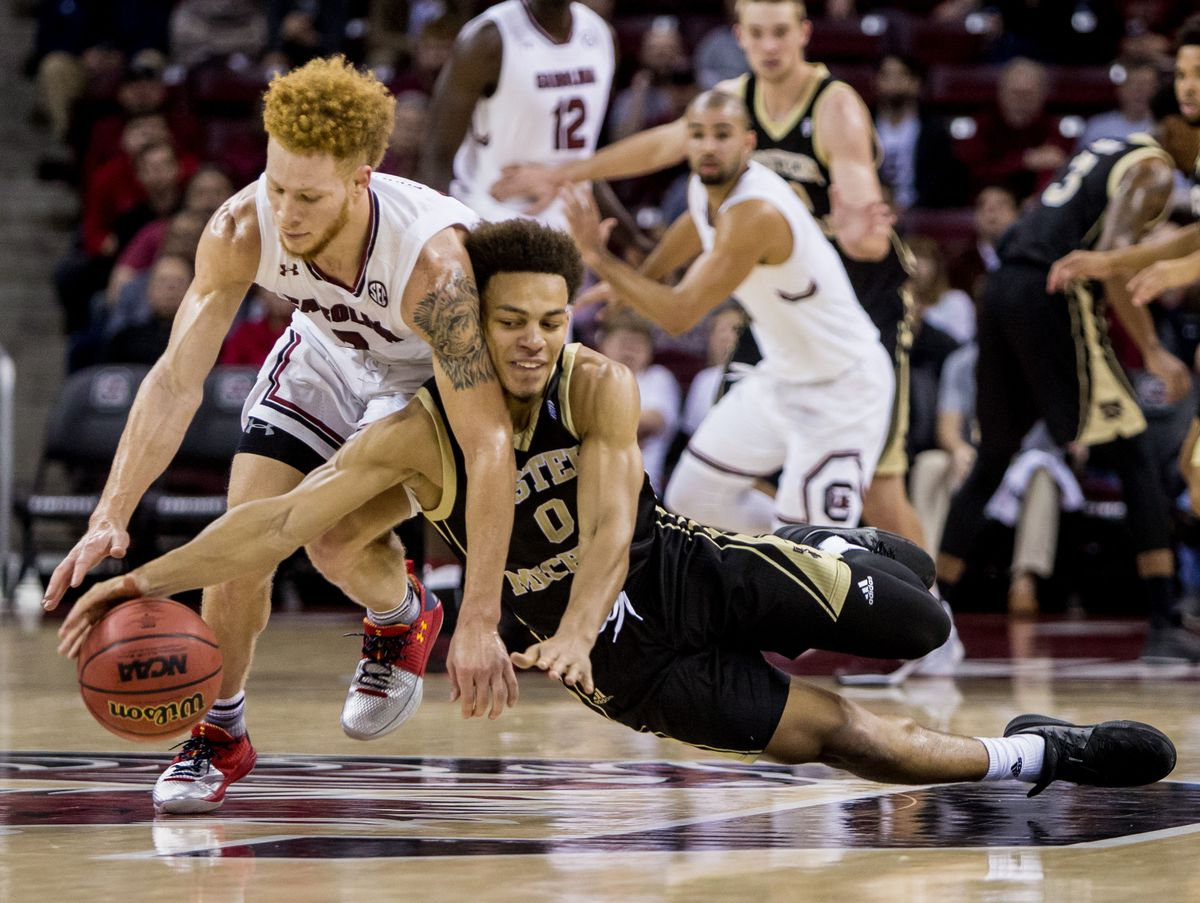 Nov 13, 2017; Columbia, SC, USA; South Carolina Gamecocks guard Hassani Gravett (2) and Western Michigan Broncos guard Bryce Moore (0) battle for the loose ball in the second half at Colonial Life Arena. Mandatory Credit: Jeff Blake-USA TODAY Sports