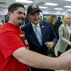 Todd Tiede, safety captain and lead cashier at Speedway's new convenience store and gas station on Beck Street in Salt Lake City, takes a photo with Gov. GaryHerbert on Monday, Nov. 25, 2019.Speedway gas stations will now sell lower-sulfur Tier 3 gasoline. The fuel, brought to Utah by Marathon Petroleum, will not cost any additional money for motorists, yet its pollution reduction in emissions is the equivalent of taking four or five cars off the road.