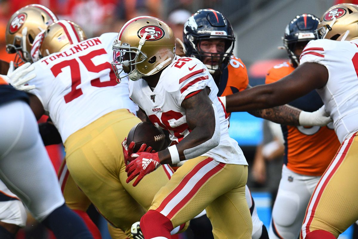 San Francisco 49ers running back Tevin Coleman carries the ball in the first quarter against the Denver Broncos at Broncos Stadium at Mile High.