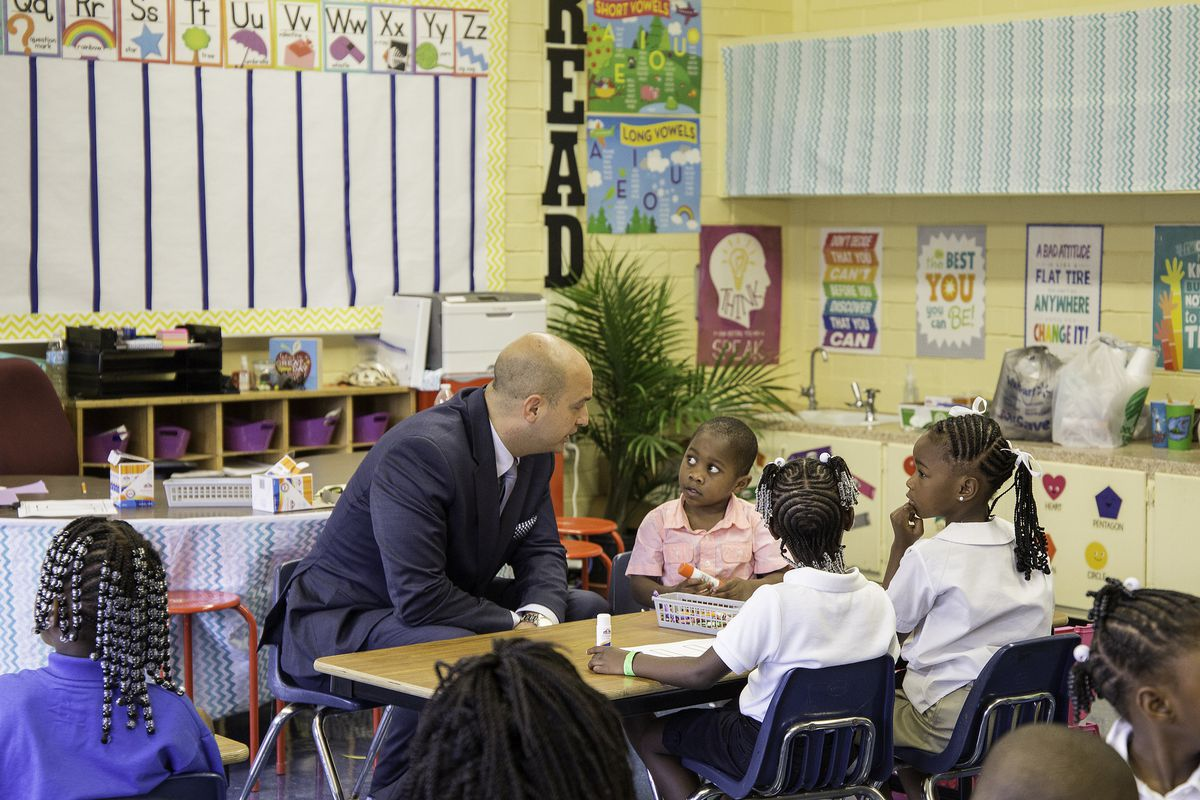 Superintendent Nikolai Vitti meets with students on the first day of school in Duval County, Florida in 2016. He was selected in 2017 to lead Detroit schools.