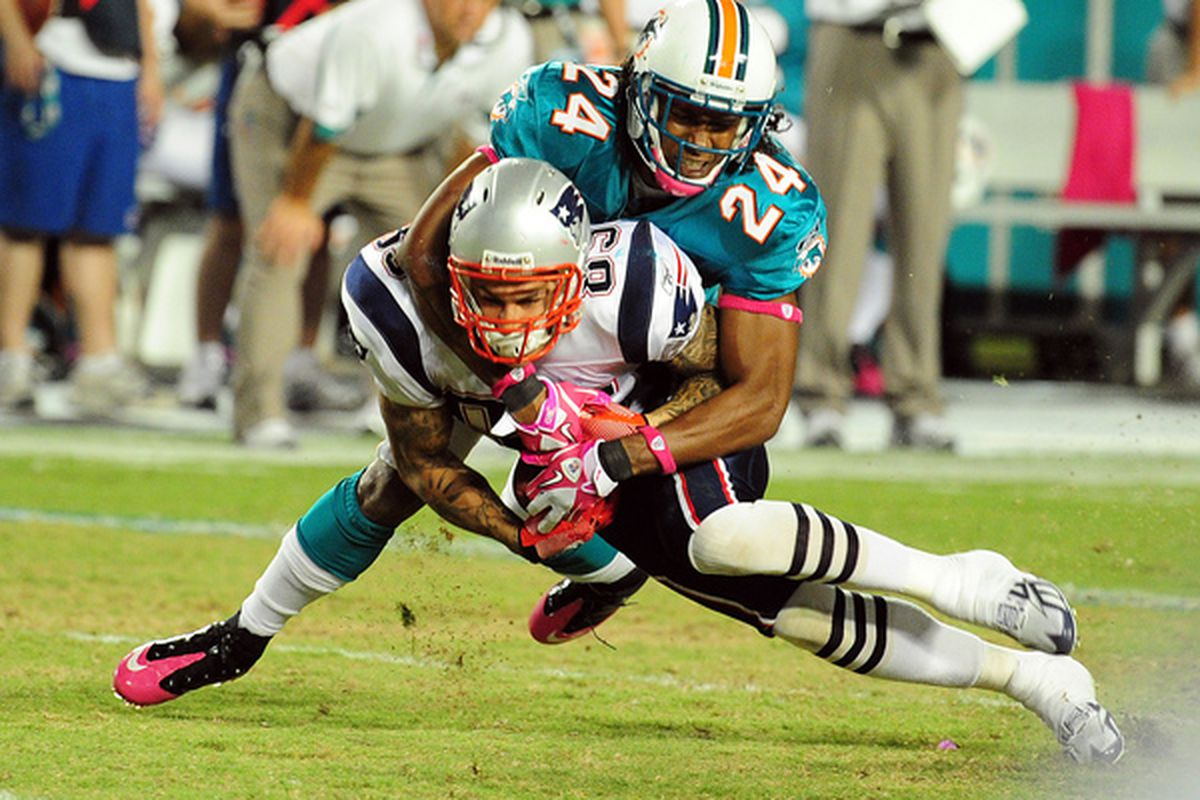 MIAMI - OCTOBER 4: Wes Welker #83 of the New England Patriots is tackled by Sean Smith #24 of the Miami Dolphins at Sun Life Field on October 4 2010 in Miami Florida. (Photo by Scott Cunningham/Getty Images)