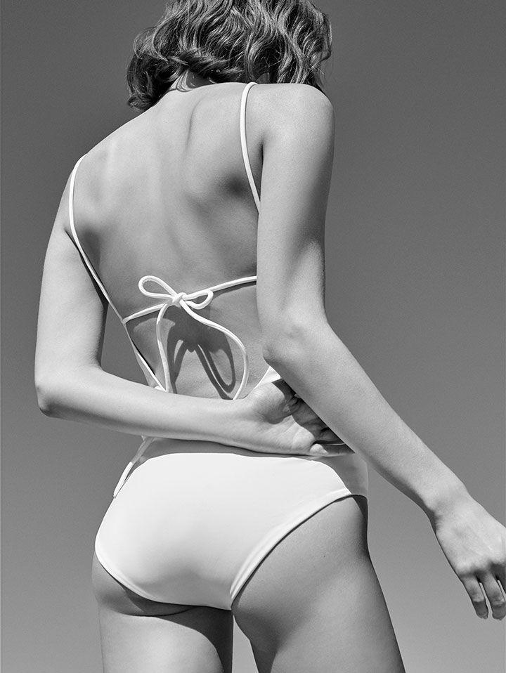back shot of model in white swimsuit