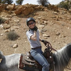 Amy Donaldson starting to choke with anticipation while riding horses in the Sid's Mountain Wilderness Study Area of the San Rafael Swell  Friday, April 1, 2011, in the San Rafael Swell in Central Utah.