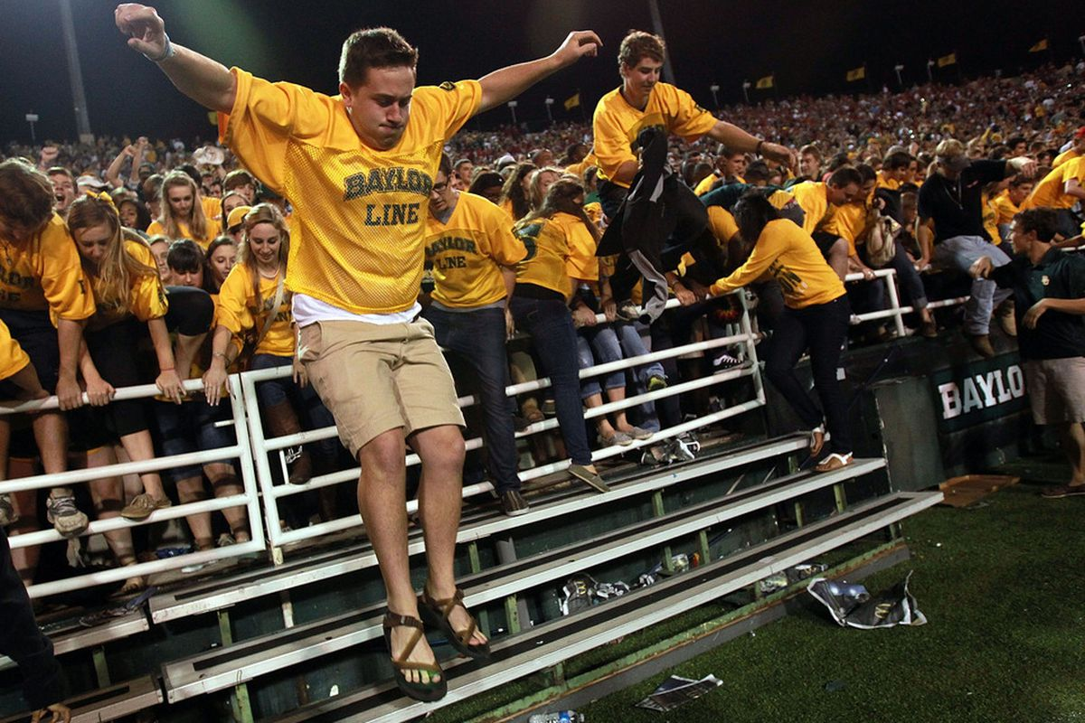 WACO, TX - NOVEMBER 19:  Baylor Bears students rush the field after a 48-35 win against the Oklahoma Sooners at Floyd Casey Stadium on November 19, 2011 in Waco, Texas.  (Photo by Ronald Martinez/Getty Images)