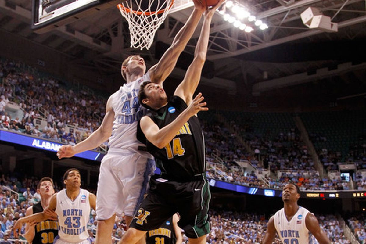 Four McGlynn #4 of the Vermont Catamounts gets blocked by Tyler Zeller  during the 2012 NCAA Men's Basketball Tournament at Greensboro Coliseum
