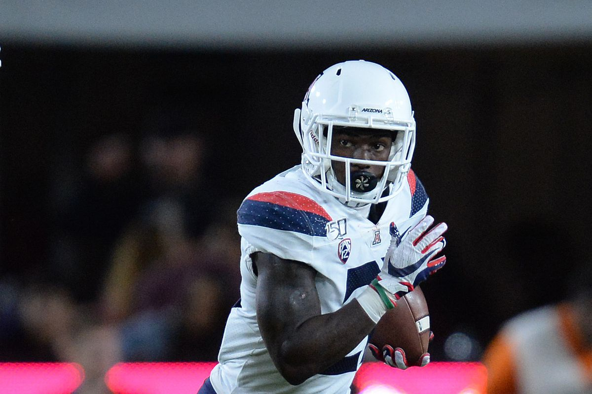Arizona Wildcats running back JJ Taylor runs the ball against the Southern California Trojans during the first half at the Los Angeles Memorial Coliseum.