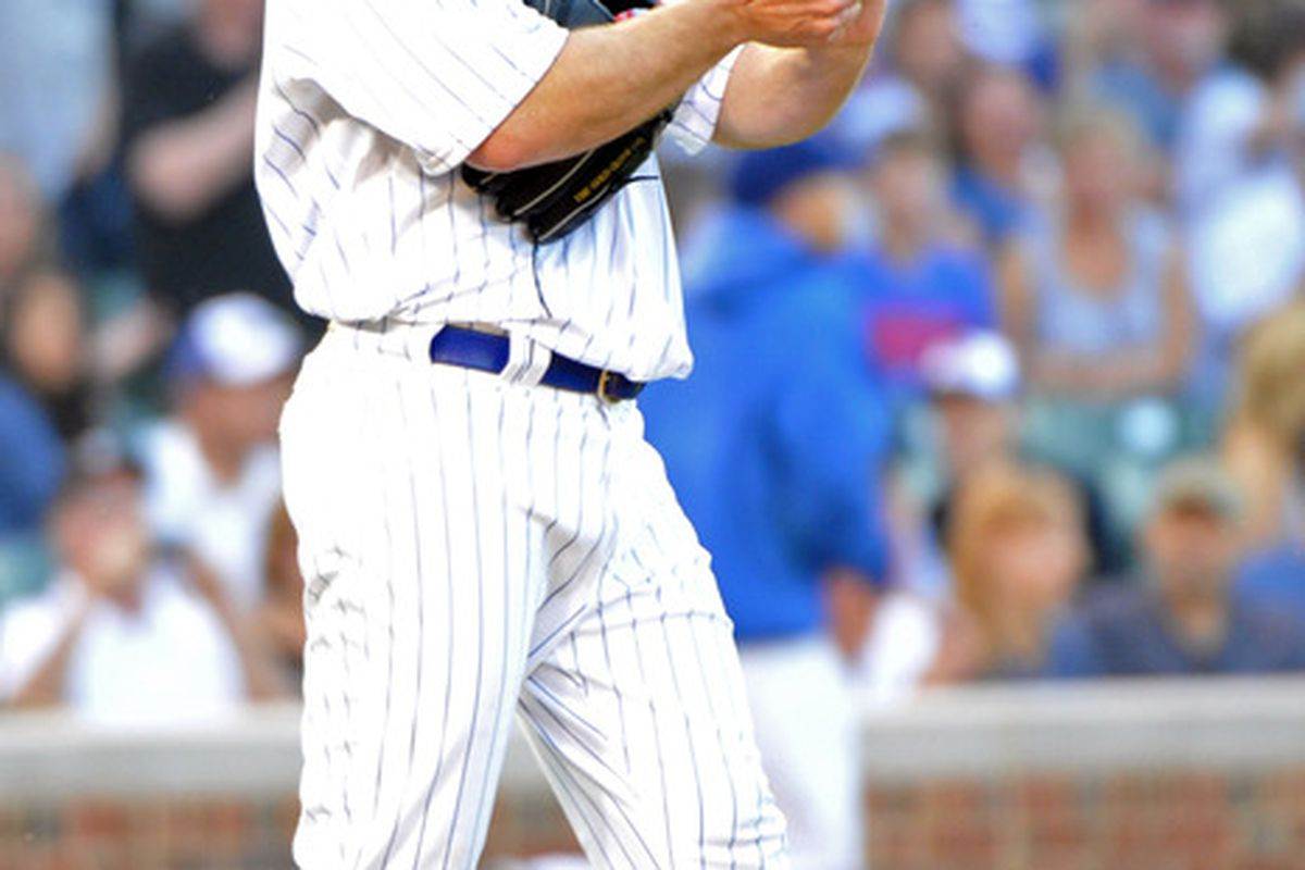 Chicago, IL, USA; Chicago Cubs starting pitcher Ryan Dempster reacts to giving up a home run against the Chicago White Sox at Wrigley Field.  Credit: Rob Grabowski-US PRESSWIRE