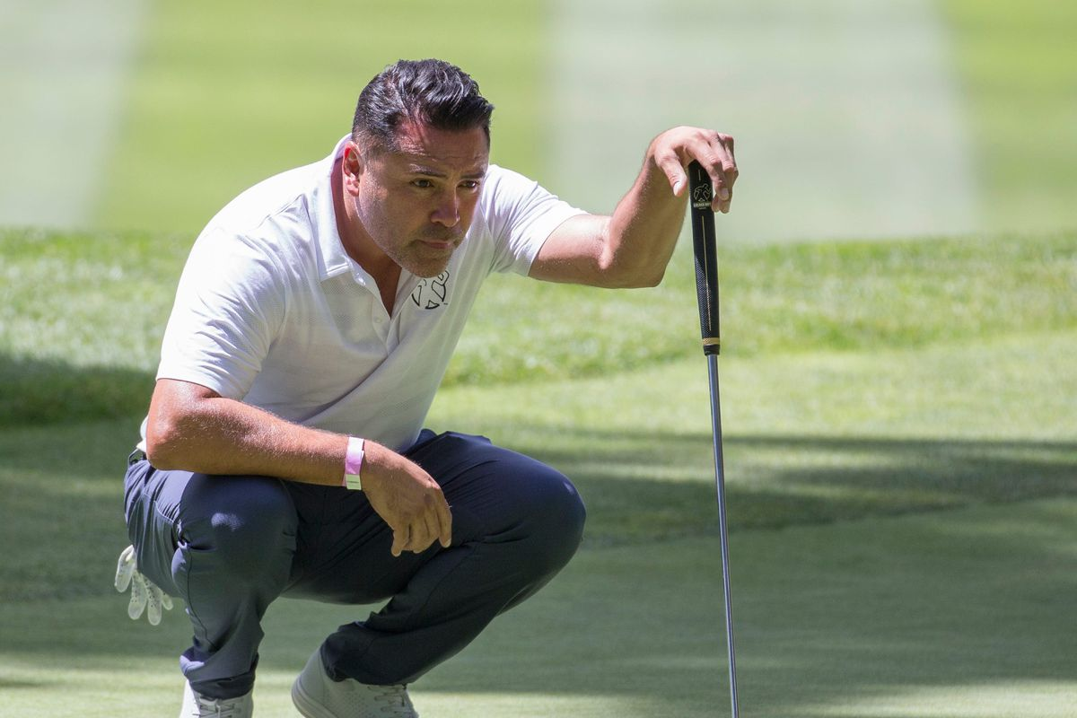 Oscar De La Hoya lines up a putt in a sport he should be doing at this age at Edgewood Tahoe Golf Course in South Lake Tahoe on Friday, July 10, 2020.